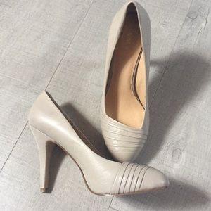 Nine West tan color shoes.
